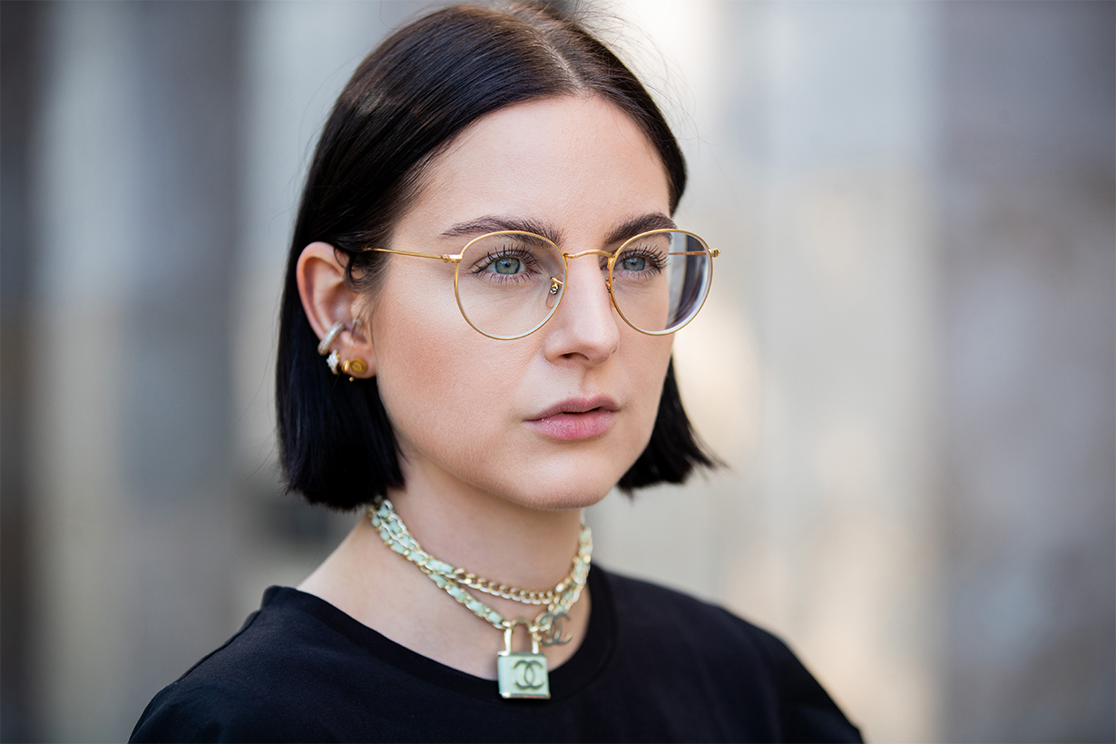 Maria Barteczko is seen wearing logo chain choker Chanel, retro glasses Ray Ban on August 25, 2019 in Duesseldorf, Germany.