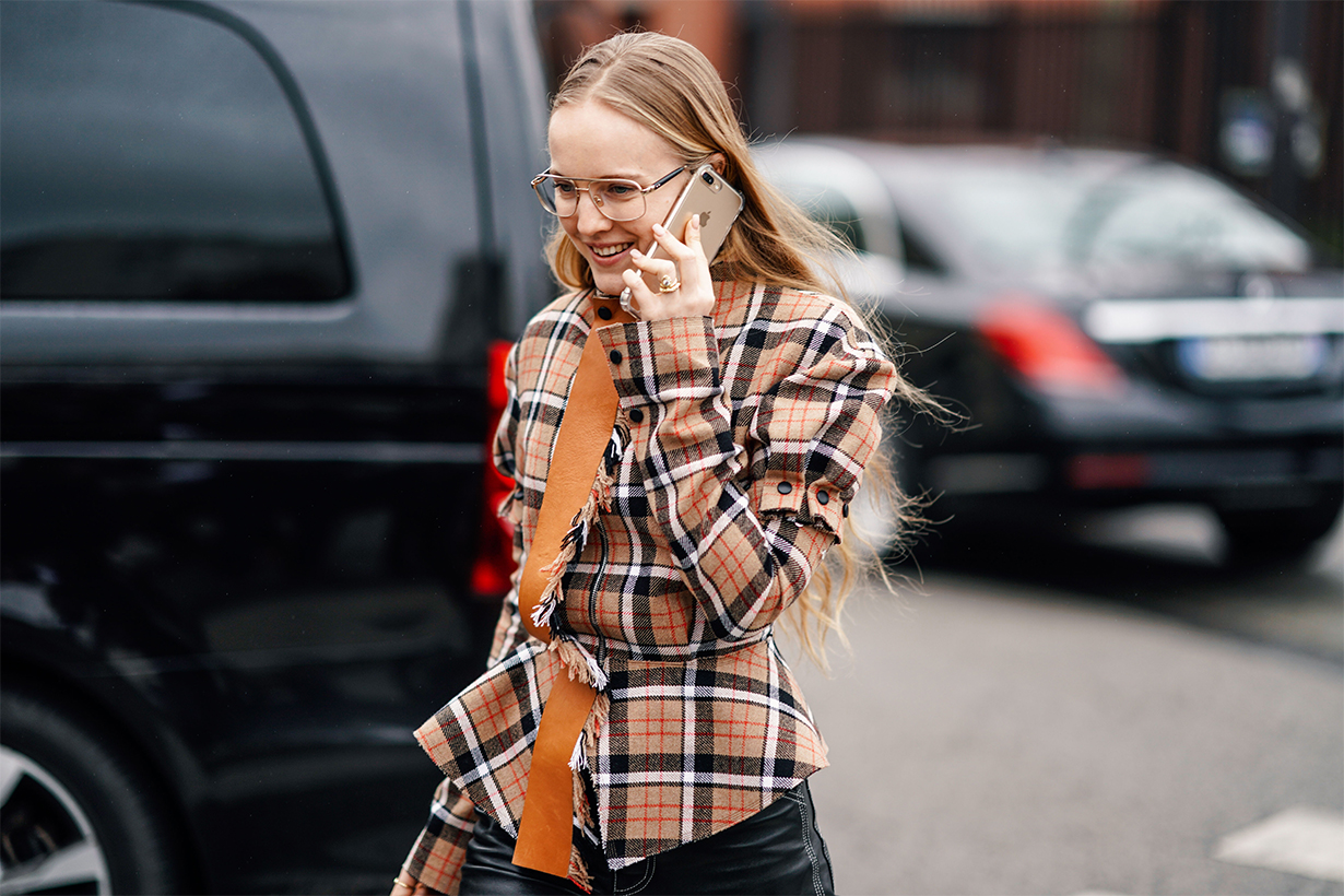 A guest wears a brown and orange checkered shirt, outside Nina Ricci, during Paris Fashion Week Womenswear Fall/Winter 2019/2020, on March 01, 2019 in Paris, France.