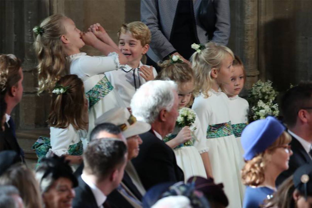 Prince George and Savannah Phillips larking around at Princess Eugenie's wedding
