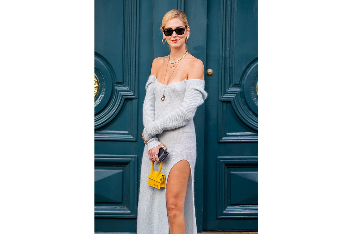 Chiara Ferragni wearing blue off shoulder dress with slit, yellow bag is seen outside Jacquemus during Paris Fashion Week Womenswear Spring/Summer 2019