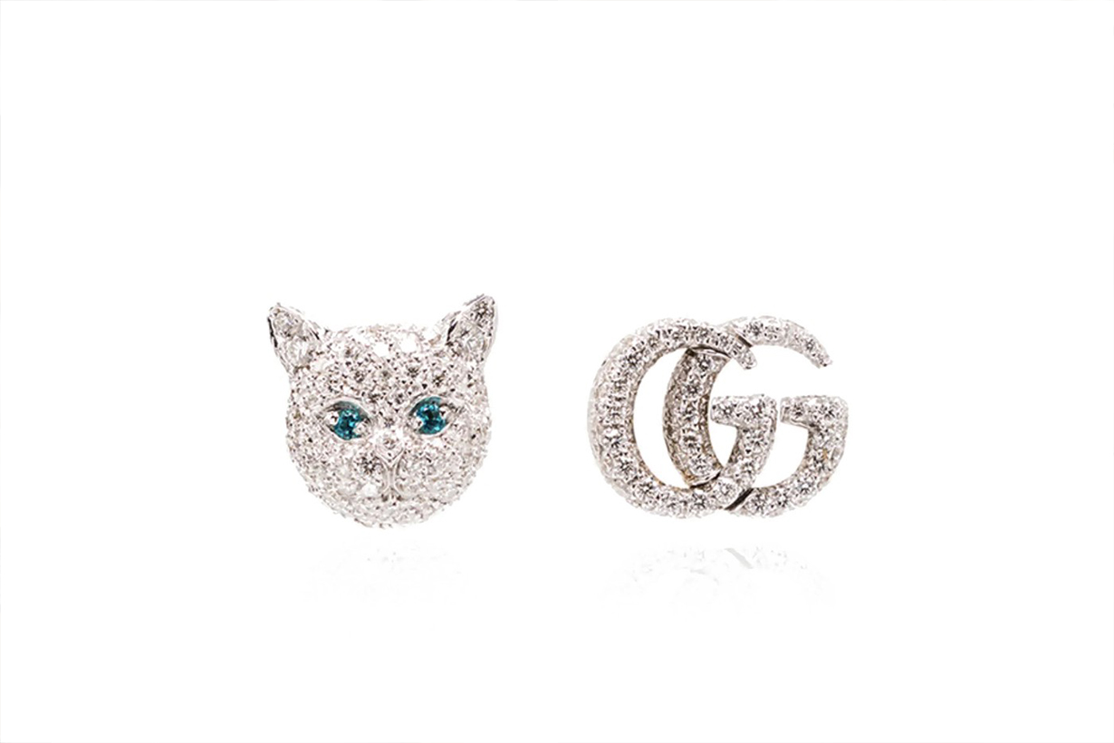gucci logo earrings white cat head and gold diamond