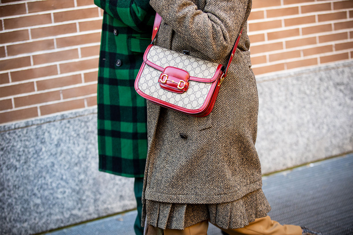 A guest, Gucci bag details, is seen outside the Fendi show during the Milan Men's Fashion Week on January 13, 2020 in Milan