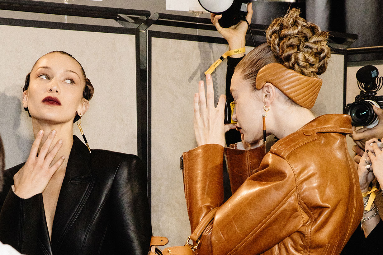 Bella Hadid pose for Gigi Hadid single-use camera during backstage at the Fendi fashion show on February 20, 2020 in Milan, Italy.