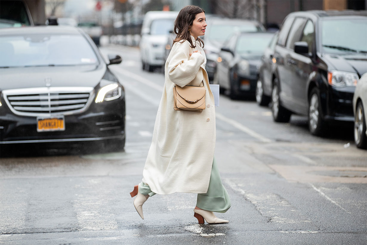 Kat Collings is seen wearing creme white coat, beige bag outside Gabriela Hearst during New York Fashion Week Fall / Winter on February 11, 2020 in New York City.