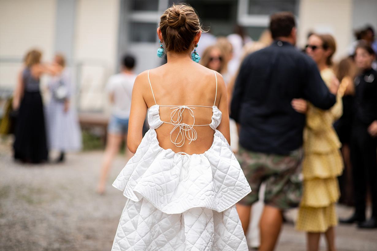 Jenny Walton wearing backless white dress is seen outside Cecilie Bahnsen during the Copenhagen Fashion Week Spring/Summer 2019 on August 8, 2018 in Copenhagen, Denmark.
