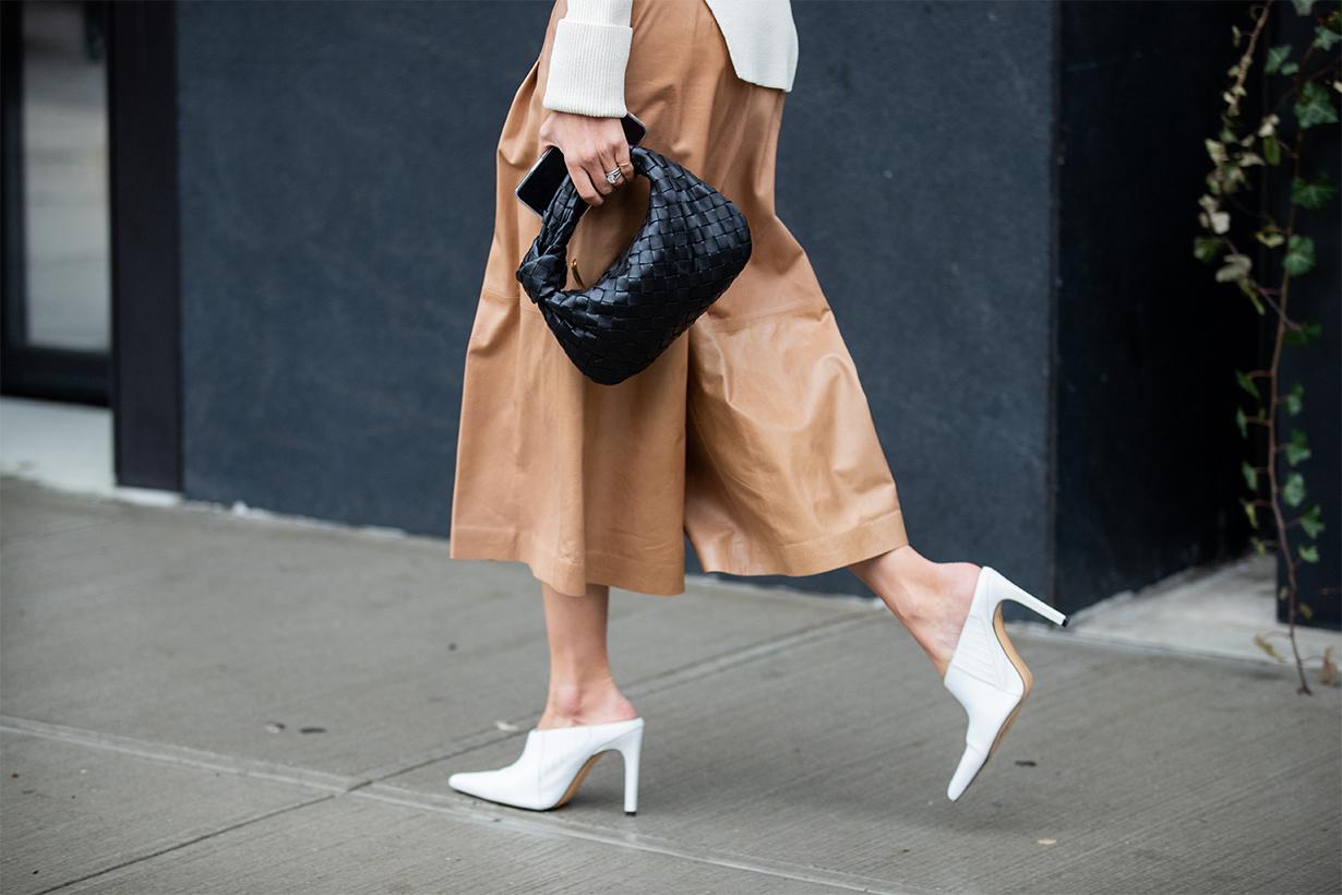 A guest is seen wearing black Bottega Veneta bag, beige cropped pants outside Tadashi Shoji during New York Fashion Week February 2020 on February 06, 2020 in New York City.