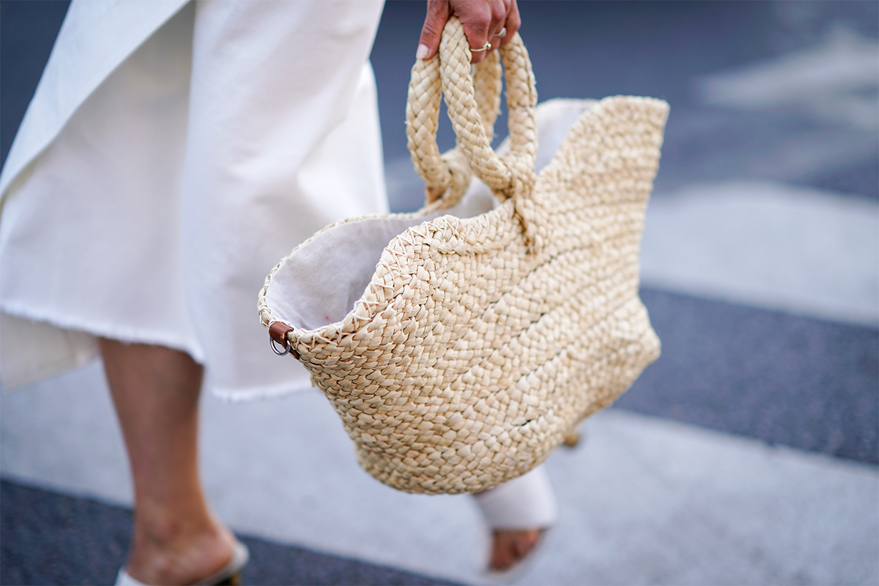 A basket bag made of straw , outside Schiaparelli, during Paris Fashion Week Haute Couture Fall Winter 2018/2019, on July 2, 2018 in Paris, France.
