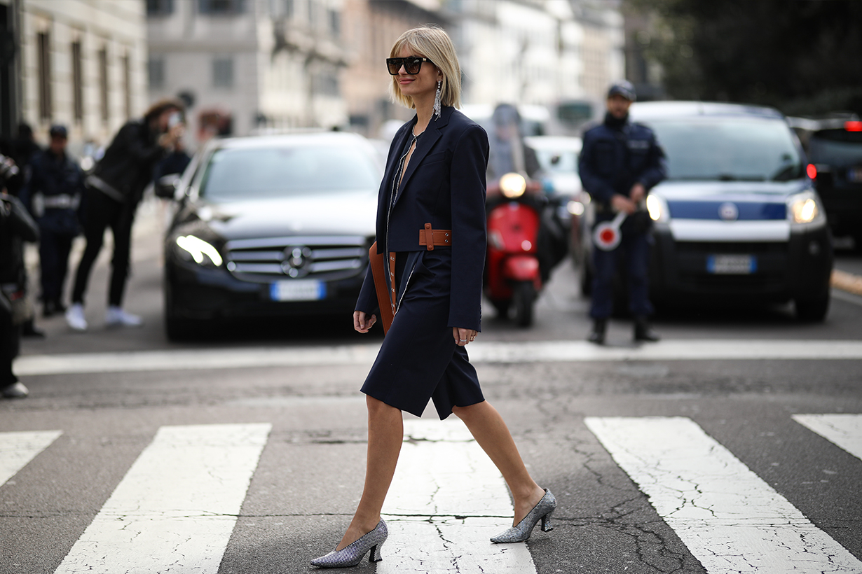 Xenia Adonts is seen wearing Bottega Veneta heels before Sportmax during Milan Fashion Week Fall/Winter 2020-2021 on February 21, 2020 in Milan, Italy.