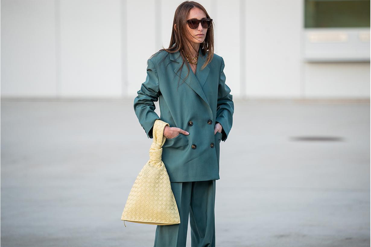Chloe Harrouche seen wearing green suit, yellow twist bag Bottega Veneta, sandals outside Jacquemus during Paris Fashion Week - Menswear F/W 2020-2021 on January 18, 2020 in Paris, France.