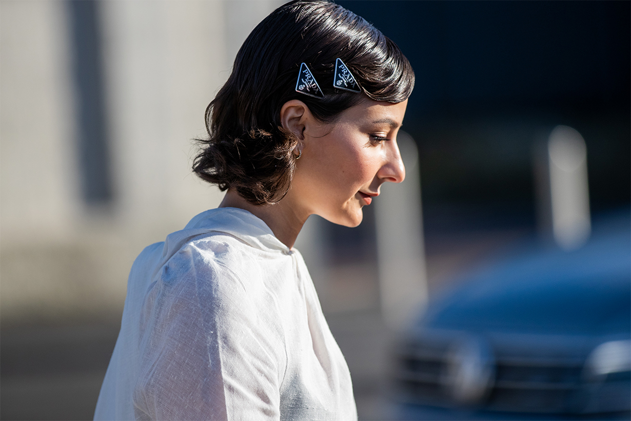Alyssa Coscarelli seen wearing white dress, prada hair clip outside Prada during Milan Fashion Week Fall/Winter 2020-2021 on February 20, 2020 in Milan, Italy.
