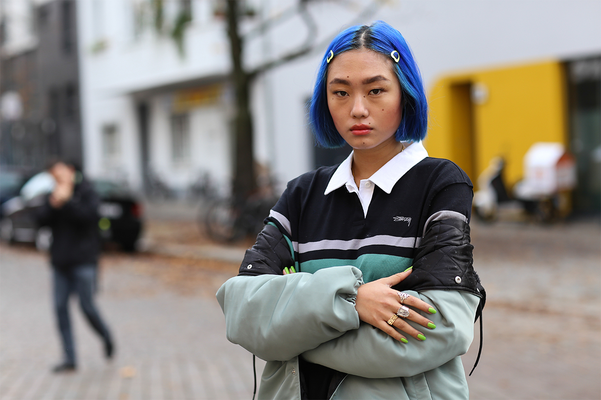 Kicki Yang Zhang wearing a Stussy jacket and shirt on November 14, 2018 in Berlin, Germany.
