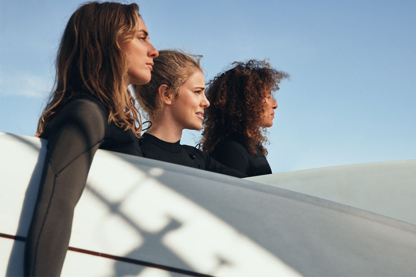HnM crossover Women + Waves swimsuit wakesurfing and wakeboarding