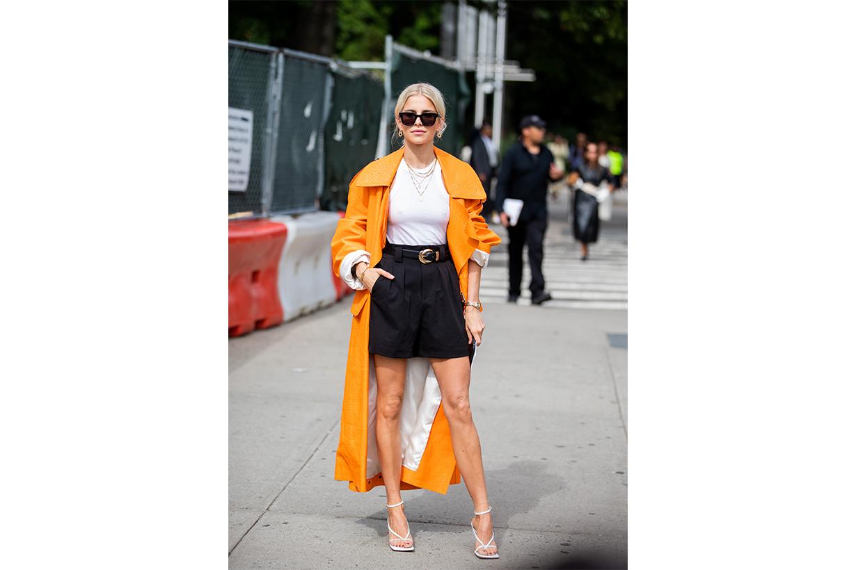 Caroline Caro Daur is seen wearing shorts, orange coat outside Tory Burch during New York Fashion Week September 2019 on September 08, 2019 in New York City.