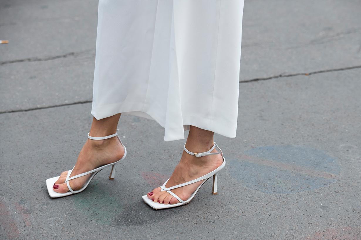 Digital influencer Caroline Daur wears Bottega Veneta shoes and Ellery trousers on September 25, 2019 in Paris, France.