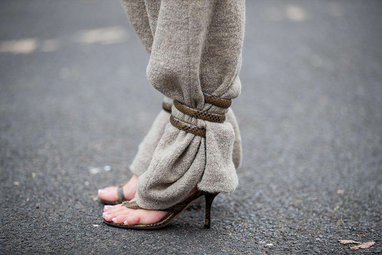 Gitta Banko is seen wearing beige pants by Boscana x Gitta Banko, python sandals with wrap around straps by Bottega Venetta on January 25, 2020 in Dusseldorf, Germany.