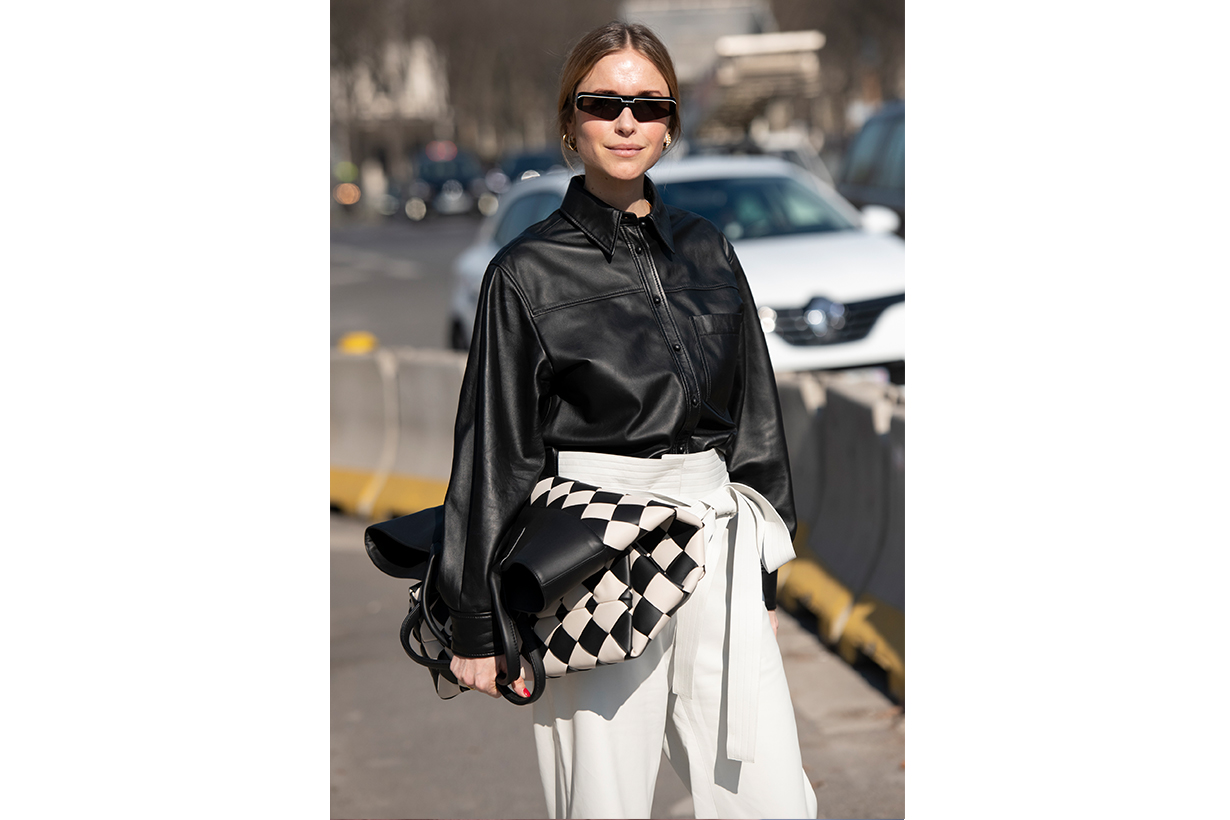 Stylist, Co-founder and Creative Director at Social Zoo Pernille Teisbaek wears Balenciaga sunglasses, Bottega Veneta bag, Loewe trousers and a Joseph shirt on February 27, 2019 in Paris, France.