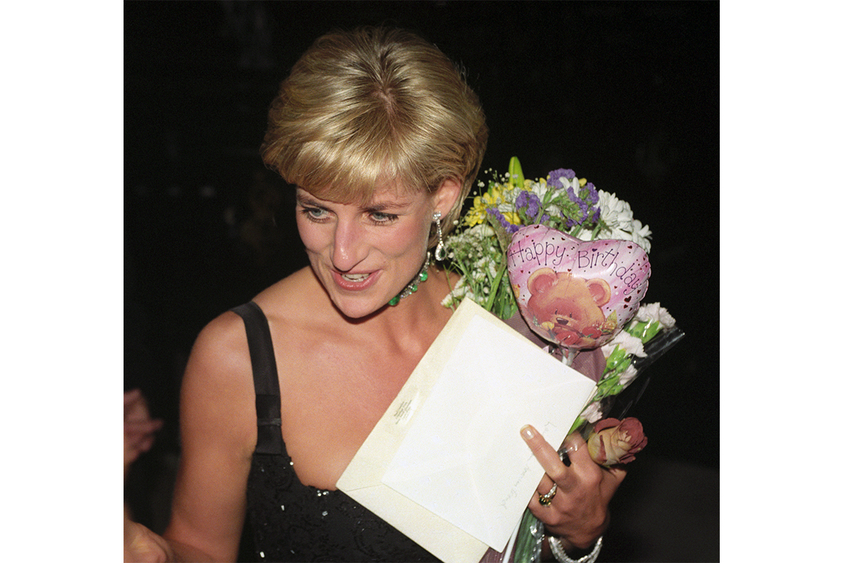 Diana, Princess of Wales, leaves the Tate Gallery's Centenary Gala Dinner carrying birthday gifts she received from friends for her 36th birthday.