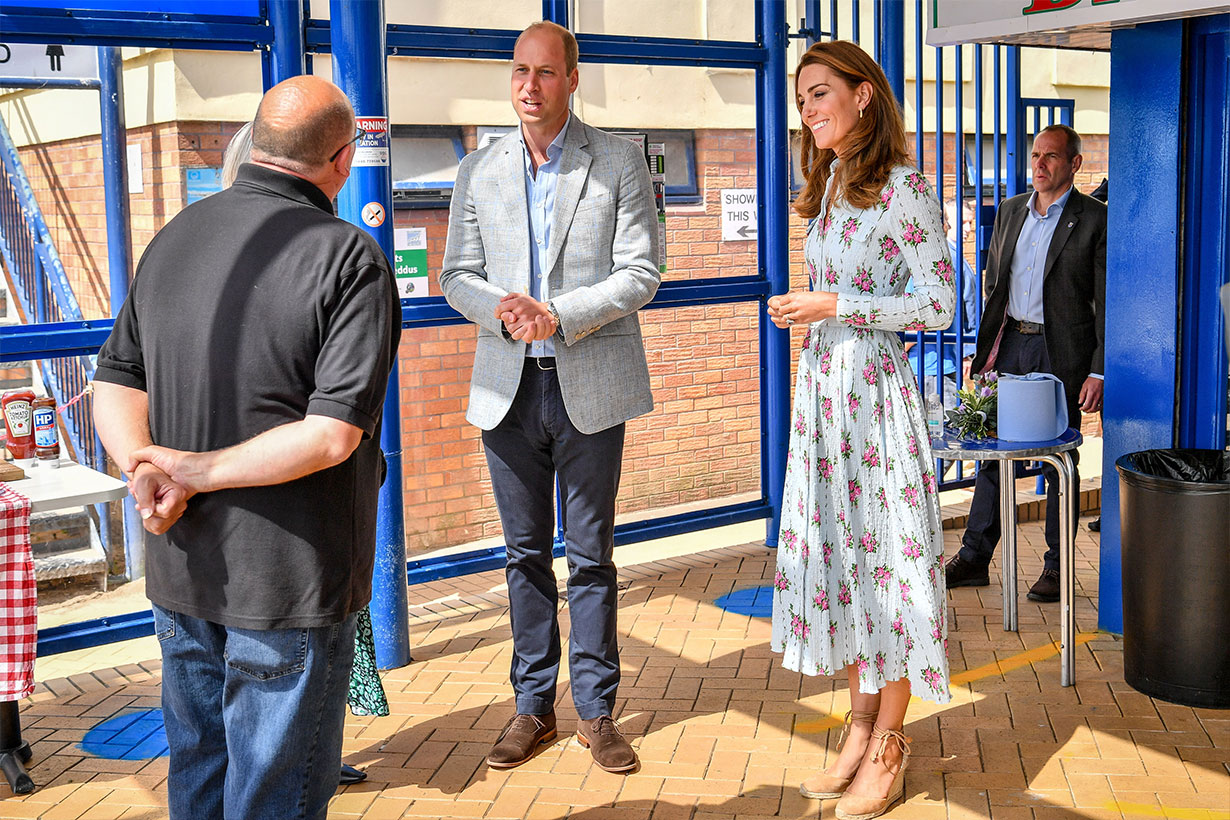 Prince William, Duke of Cambridge and Catherine, Duchess of Cambridge meet owner of Marco's cafe, Marco Zeraschi, during their visit to Barry Island, South Wales, to speak to local business owners about the impact of COVID-19 on the tourism sector on August 5, 2020 in Barry, Wales.