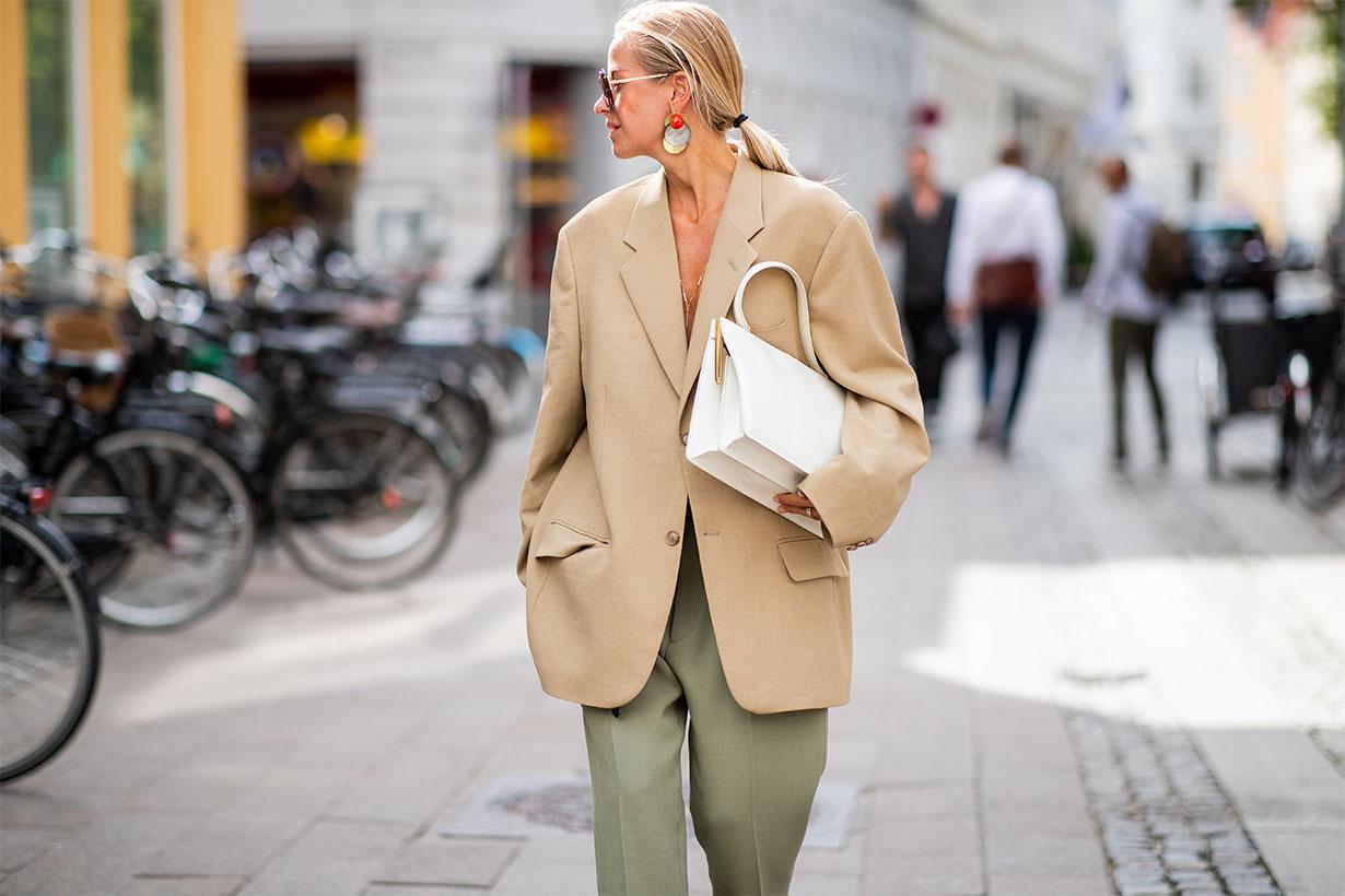 Celine Aagaard wearing beige oversized blazer, olive green pants, pointed flats seen outside Blanche during the Copenhagen Fashion Week Spring/Summer 2019 on August 7, 2018 in Copenhagen, Denmark.