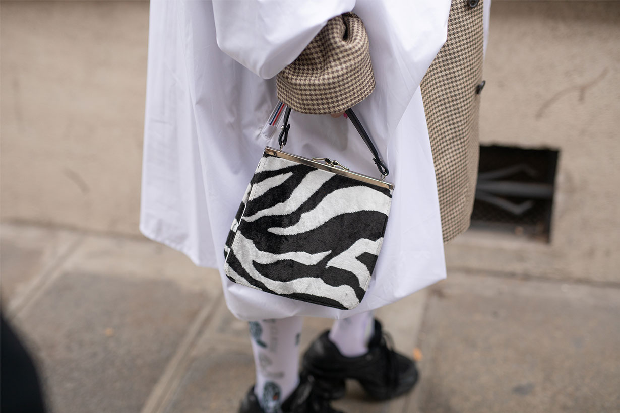 A guest is seen on the street attending Y/PROJECT during Paris Fashion Week AW19 wearing zebra print bag on February 28, 2019 in Paris, France.