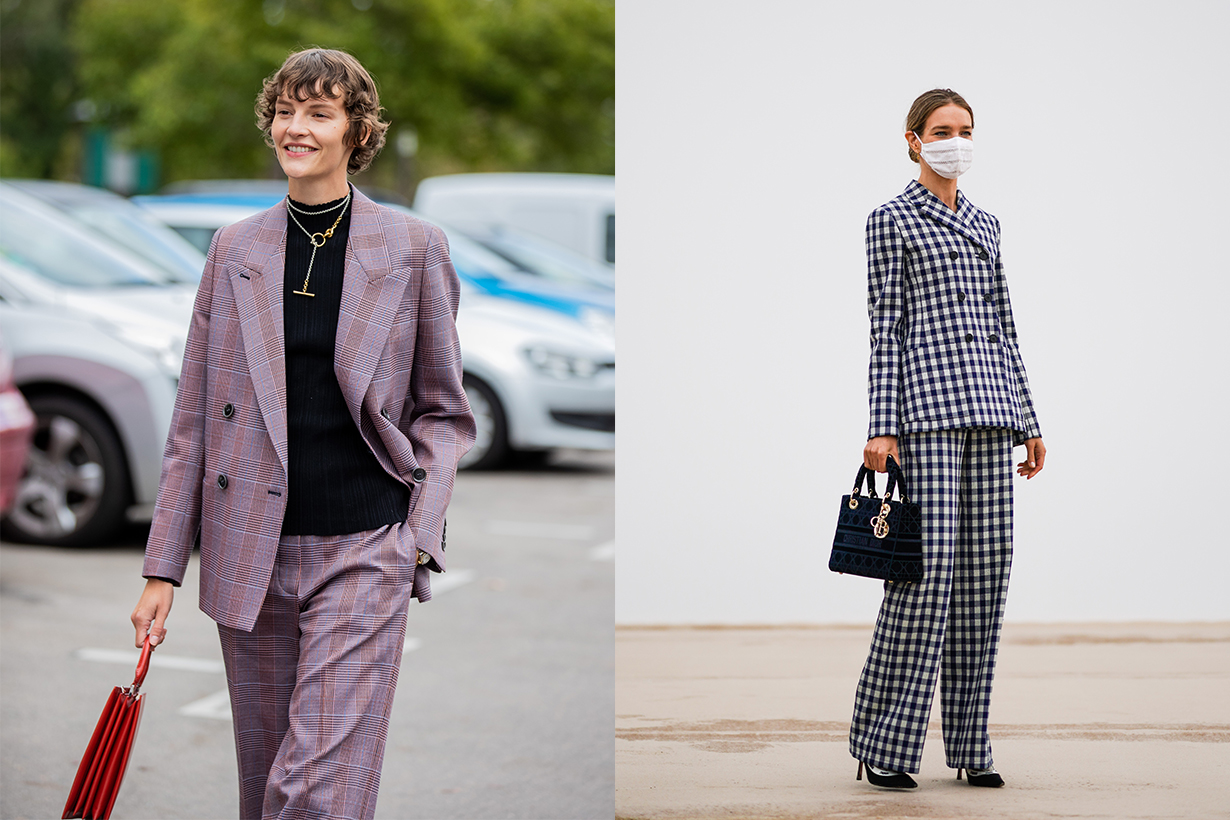 Natalia Vodianova wears a white protective face mask, a black and white checked blazer jacket, a Dior Lady Dior bag, flared pants, J'Adior pointy shoes, outside Dior, during Paris Fashion Week - Womenswear Spring Summer 2021 on September 29, 2020 in Paris, France.