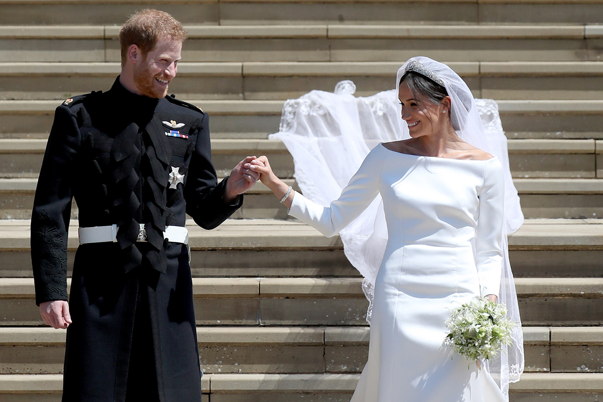 Prince Harry, Duke of Sussex and the Duchess of Sussex depart after their wedding ceremonyat St George's Chapel at Windsor Castle on May 19, 2018 in Windsor, England.