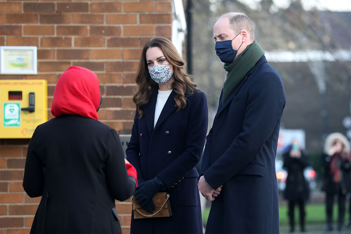 Britain's Prince William, Duke of Cambridge (R) and Britain's Catherine, Duchess of Cambridge (C) meet volunteers who have supported elderly members of their local community throughout the COVID-19 pandemic at Batley Community Centre in northern England on December 7, 2020, on their first full day of engagements on their tour of the UK. - During their trip, their Royal Highnesses hope to pay tribute to individuals, organisations and initiatives across the country that have gone above and beyond to support their local communities this year. (Photo by Danny Lawson / POOL / AFP) (Photo by
