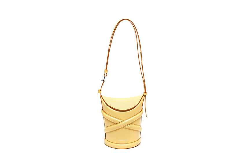 THE CURVE CRISSCROSS DETAIL SMALL LEATHER BUCKET TOTE width=